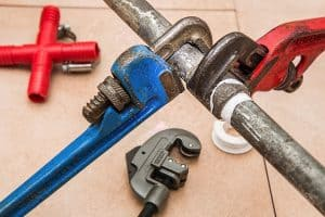 plumbing wrench and pipe - successful plumbing company